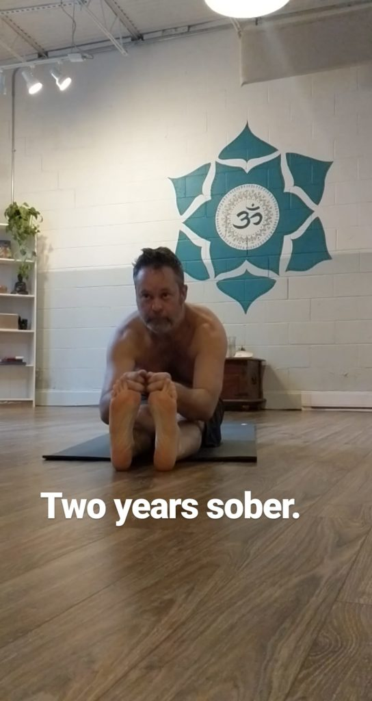 Butler doing paschimottanasan at two years sober