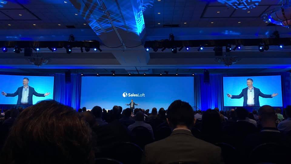 Butler Raines speaking from stage at SalesLoft's conference