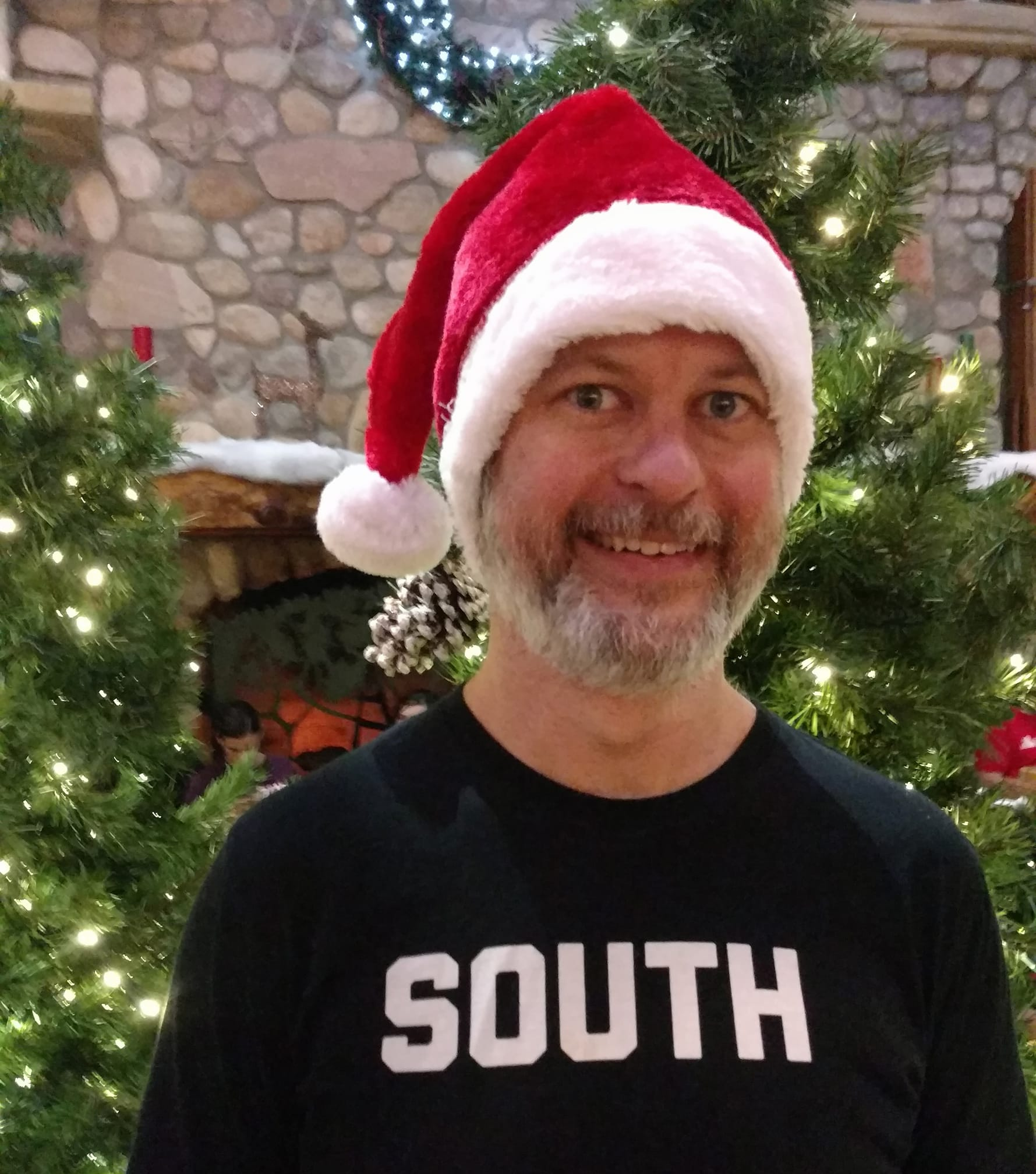 Butler in Bitter Southerner shirt and Christmas hat